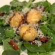 Fried sous vide egg yolk salad